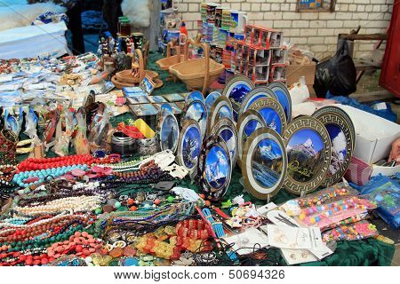 Souvenir products on a small counter with symbols of Dombai