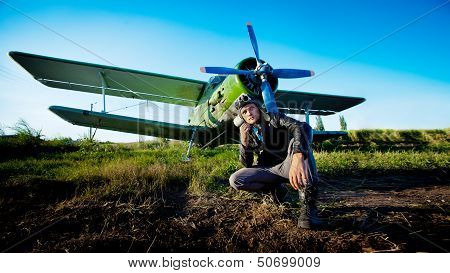Pilot Is Sitting In Front Of Vintage Plane