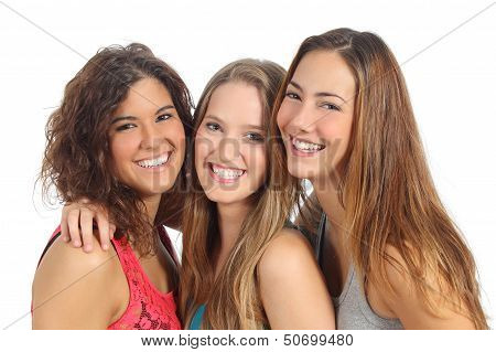 Group Of Three Women Laughing And Looking At Camera