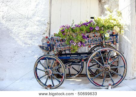 Charming Decorative Cart With Flowers At The Street In Village Of Emporio On Cyclades, Greece