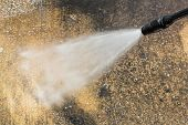 stock photo of pressure  - Floor cleaning with high pressure water jet - JPG