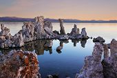 The magic of Mono Lake. Outliers - bizarre limestone calcareous tufa formation on the smooth water o