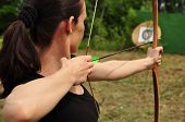 foto of bow arrow  - Young women training with the old bow - JPG