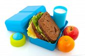 picture of lunch box  - Healthy filled lunch box with whole meal bread vegetables and milk - JPG