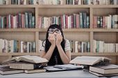 Asian Female Student Worry At Library