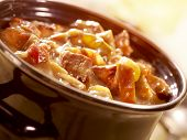 stock photo of stew pot  - a fresh and tasty stew in a pot with beef tomato and an nice sauce ready to eat - JPG