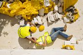 foto of hurted  - Construction worker has an accident while working on new house - JPG