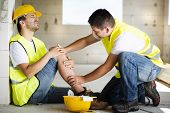 stock photo of worker  - Construction worker has an accident while working on new house - JPG