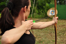 stock photo of longbow  - Young women training with the old bow - JPG