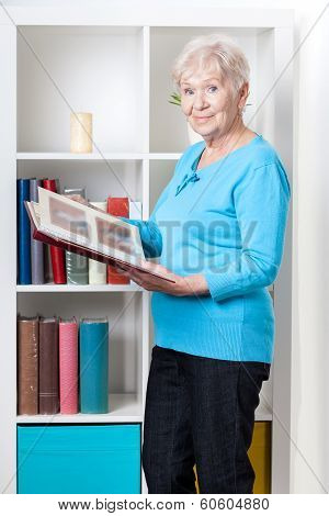 Elderly Woman Looking Through Photo Album