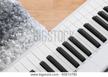 Close-up Of Electric Piano And Chair
