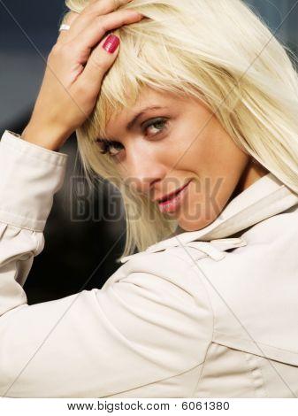 Closeup Of Beautiful Sexy Blond Woman In Coat