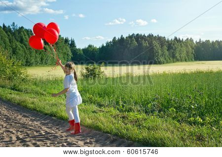 Girl Walking On A Country Road