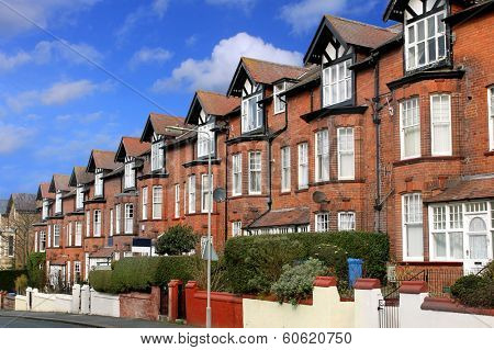 Row of old terraced houses on a street, Scarborough, England.