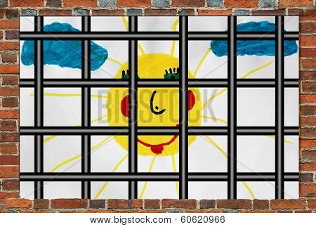 Prison window with bars and children's drawing