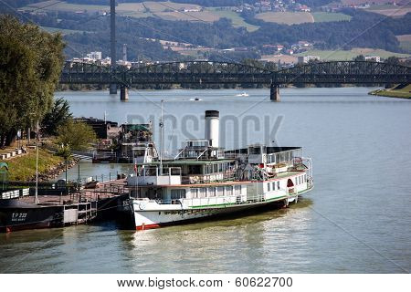 the capital of upper austria in austria is linz. an old steam boat on the danube