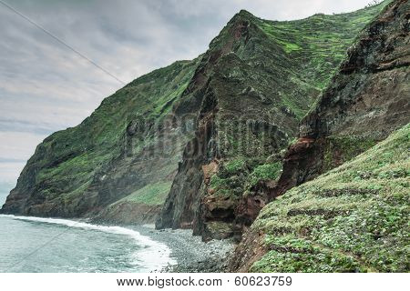View of beautiful mountains and ocean on northern coast near Boaventura Madeira island Portuga