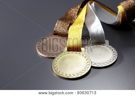 gold,silver and bronze medals in a group