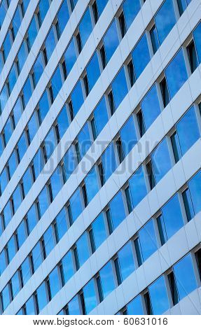 Blue Sky Reflected In Windows Of A Skyscraper