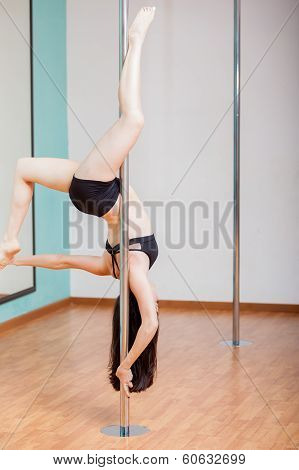 Pretty girl pole dancing