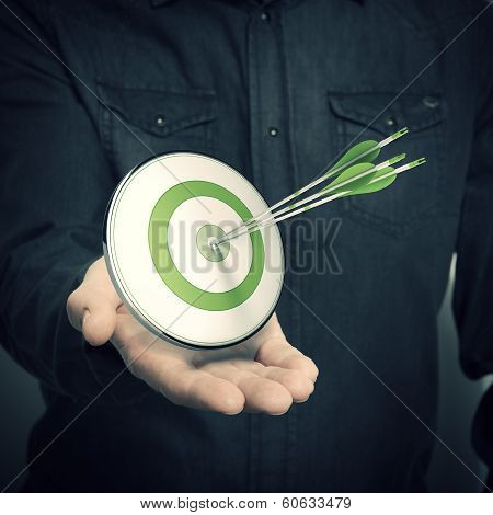 Man Holding Green Target - Marketing Solutions Concept