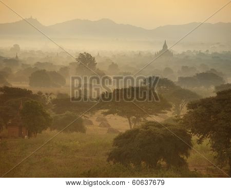 Misty Sunrise Over Ancient Architecture Of Old Buddhist Temples At Bagan Kingdom, Myanmar (burma). T