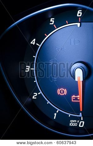 Fragment of instrument panel of car tachometer, visible symbols of instrument.