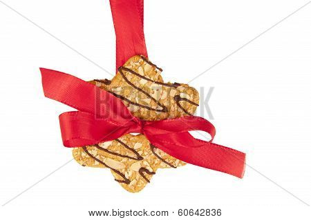 Biscuit Hanging On Celebratory Ribbon