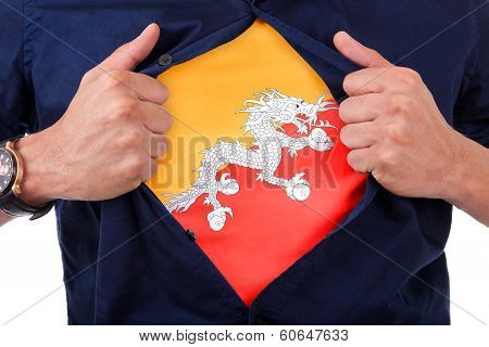 Young Sport Fan Opening His Shirt And Showing The Flag His Country Bhutan , Bhutanese Flag