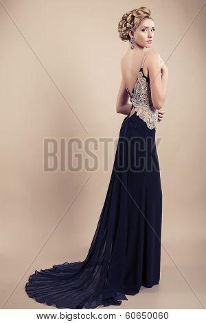 beautiful blond woman in elegant black dress