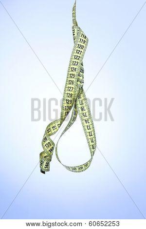 Tape measure noose on blue background - diet concept
