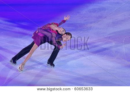 MOSCOW, RUSSIA - FEBRUARY 24, 2014: Vera Bazarova and Yuri Larionov in action during Gala concert of Olympic champions in figure skating in Luzhniki