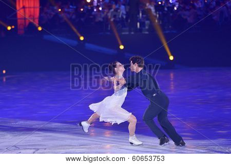 MOSCOW, RUSSIA - FEBRUARY 24, 2014: Tessa Virtue and Scott Moir in action during Gala concert of Olympic champions in figure skating in Luzhniki