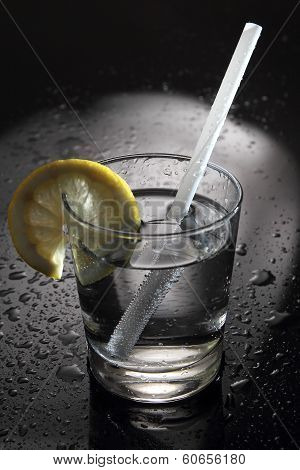 Water Or Cocktail On A Bar With Water Drops