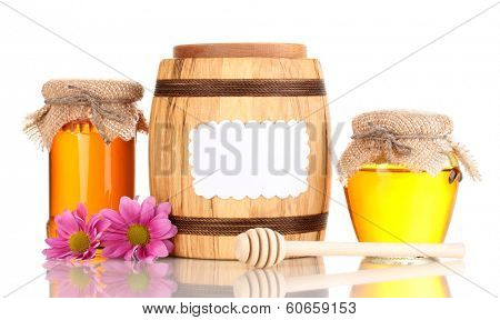Sweet honey in jars and barrel with drizzler isolated on white