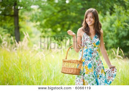 Pretty Young Woman With Basket In A Forest