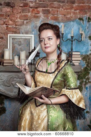 Beautiful Woman In Medieval Dress Writing In Diary