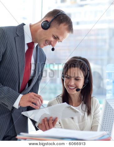 Manager Talking To A Businesswoman In A Call Center