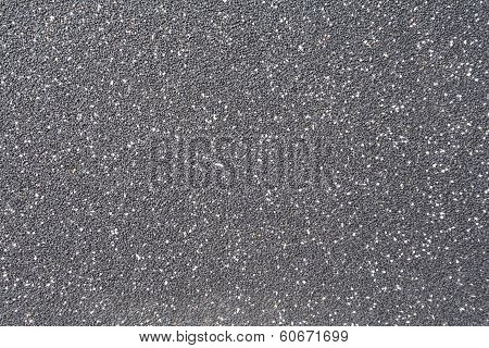 Texture of black rubber floor on playground