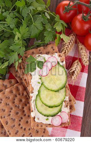 crispbread with cheese,radish and cucumber