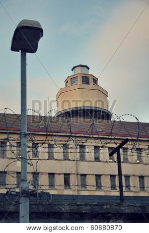 Barbed wire around prison walls