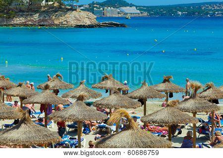 People Sunbathing At Paguera Beach, Majorca, Spain