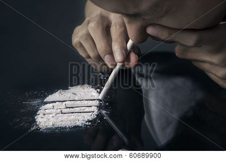 Drug User Inhales Cocaine