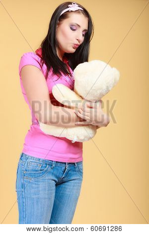 Childish Young Woman Infantile Girl In Pink Kissing Teddy Bear Toy