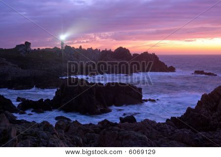 Coastline And Lighthouse At Dusk