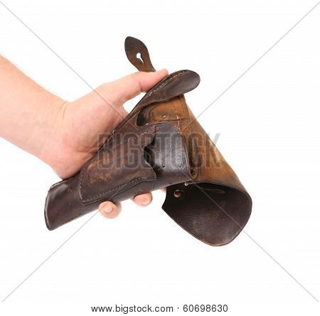 Hand holds old brown holster.