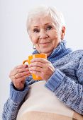 picture of politeness  - Grandmother with cup of ea on white isolated background - JPG