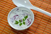 image of raita  - Raita an indian dish made of yogurt coriander and onions - JPG