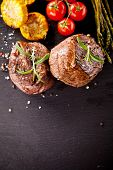 stock photo of ribeye steak  - Pieces of red meat steaks with vegetable and spices - JPG