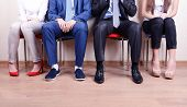 foto of foot  - Business people waiting for job interview - JPG
